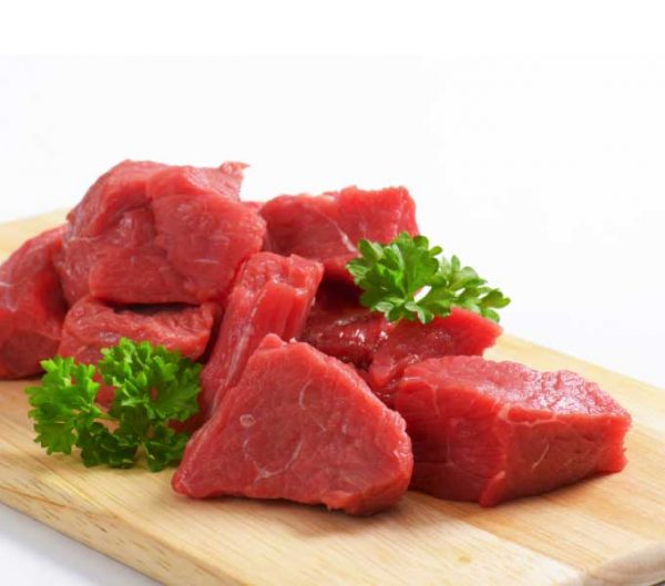 diced beef on wooden board